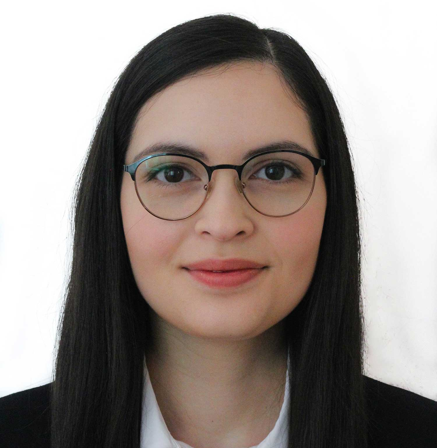 portrait of woman with straight long black hair and glasses