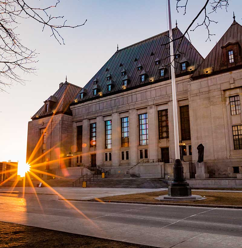 exterior of supreme court building in ottawa ontario at sunset